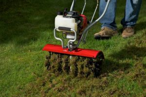lawncare made easy with a mantis tiller aerator attachment