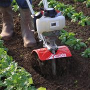 Mantis 4-stroke tiller cultivating between rows